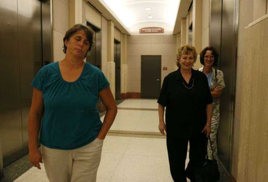 Rhonda Tavey, left, leaves the Harris County Criminal Courthouse Friday. She says she took the children for their own safety. Photo: SHARoN STEINMANN, CHRONICLE