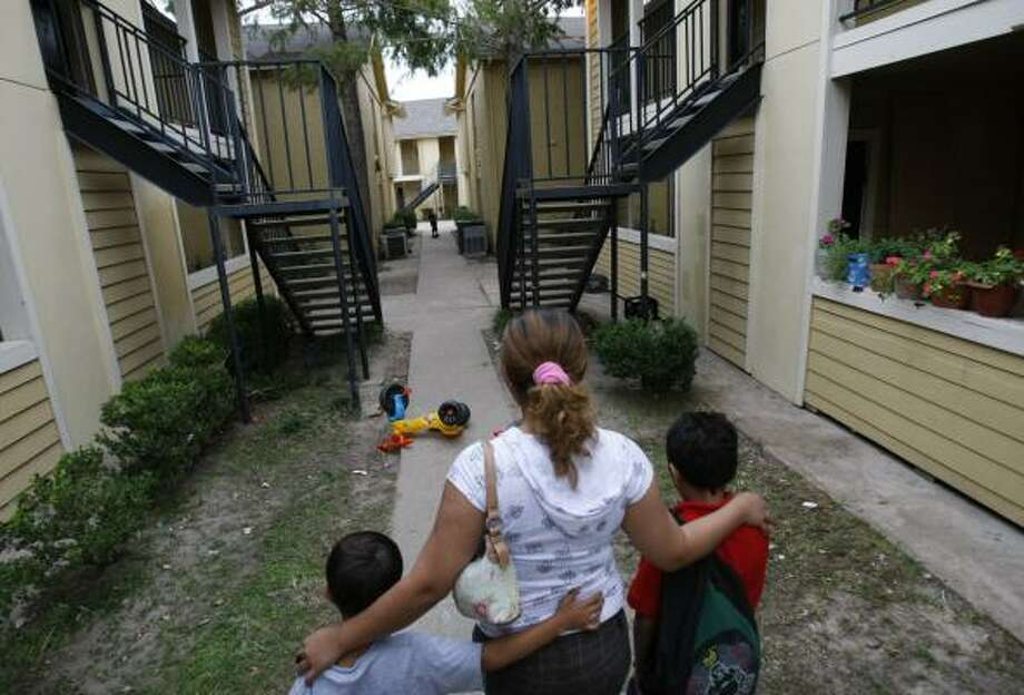 A victim of Houston's sex-trafficking ring is now living with her two sons, ages 6 and 9. They were reunited last summer after she spent more than two years getting visas for herself and her boys. Photo: JULIO CORTEZ, CHRONICLE