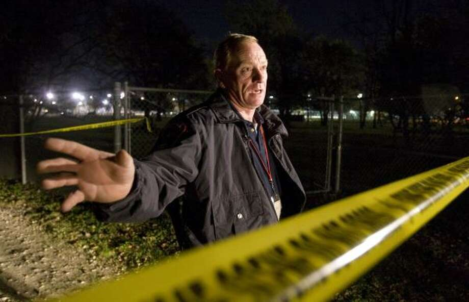 Harris County Precinct 5 Assistant Chief Constable J.J. Laine shows where someone broke into Bear Creek Pioneer Park's Wildlife Sanctuary and decapitated Mr. Buck, the 10-year-old whitetail deer known for his affection for visitors. Brandon Eugene Gregory is charged in the case. Photo: NICK De La TORRE, CHRONICLE