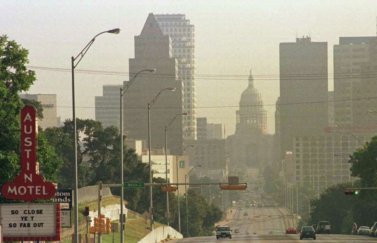 Effects of air pollution are shown in this view of the skyline of downtown Austin, Texas, picture taken during period of stagnant hot air mass. . (AP Photo/Harry Cabluck)