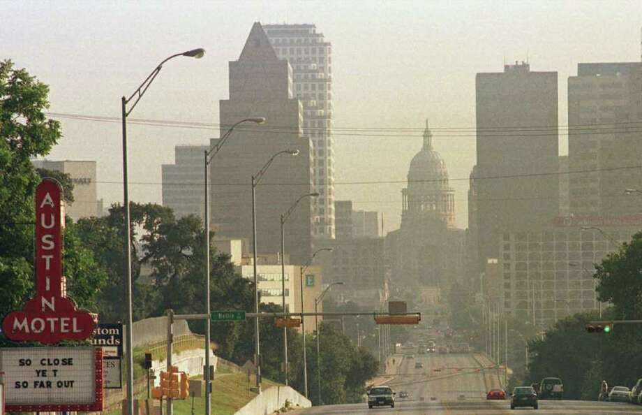 Effects of air pollution are shown in this view of the skyline of downtown Austin, Texas, picture taken during period of stagnant hot air mass. . (AP Photo/Harry Cabluck) Photo: HARRY CABLUCK, ASSOCIATED PRESS / AP1999