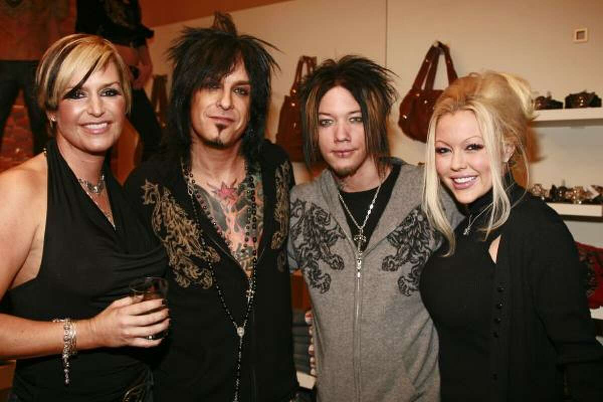Kelly Gray, left, and Mötley Crüe bassist Nikki Sixx, second from left, appeared together at an Aspen boutique to promote their Royal Underground clothing line, which combines edgy styles with luxe fabrics.