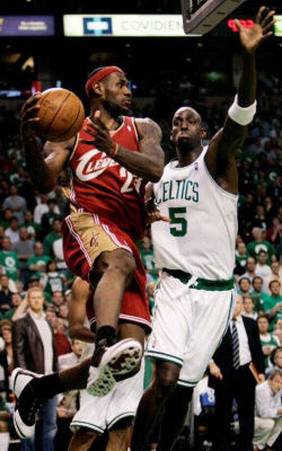 Boston Celtics forward Kevin Garnett (5) pressures Cleveland Cavaliers forward LeBron James, left, who passes the ball during the third quarter in Game 5 of an NBA Eastern Conference semifinal series in Boston on Wednesday. Photo: Charles Krupa, AP