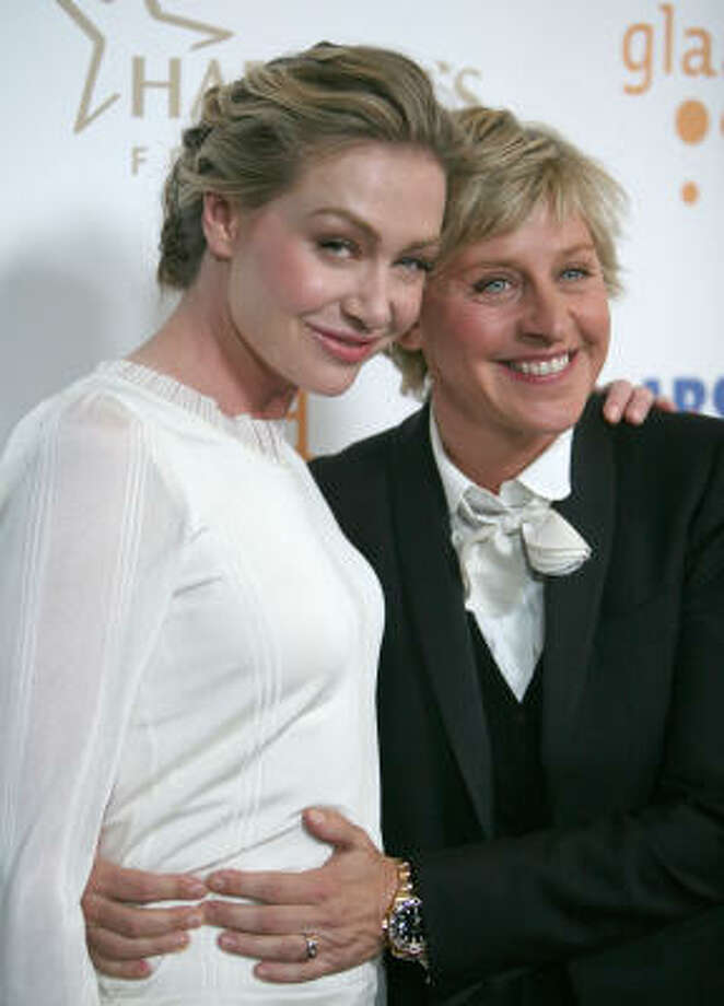 People and Us Magazine is reported Saturday that Ellen DeGeneres, 50, and Portia de Rossi, 35, wed Saturday night in an intimate ceremony at their Beverly Hills home. Photo: Associated Press File