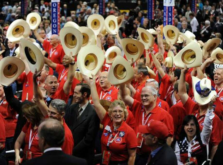 Members of the Texas delegation salute the flag on the second day of the Republican National Convention in St. Paul, Minn., on Tuesday. Photo: OLIVIER DOULIERY, ABACA PRESS/MCT
