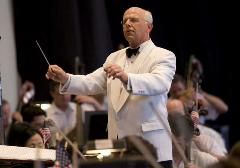 Michael Krajewski, principal pops conductor for the Houston Symphony, conducts the symphony in July during the annual Independence Day concert. Photo: Brett Coomer, Houston Chronicle