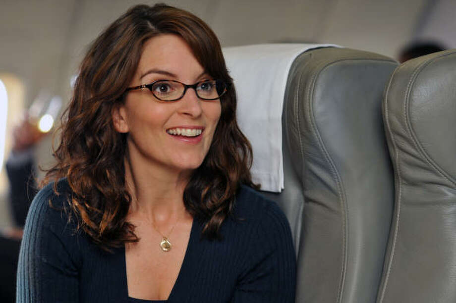 "Who is making Liz Lemon smile so big? Why Oprah Winfrey of course. Winfrey guest-stars on ""30 Rock"" this Thursday. Photo: NBC"