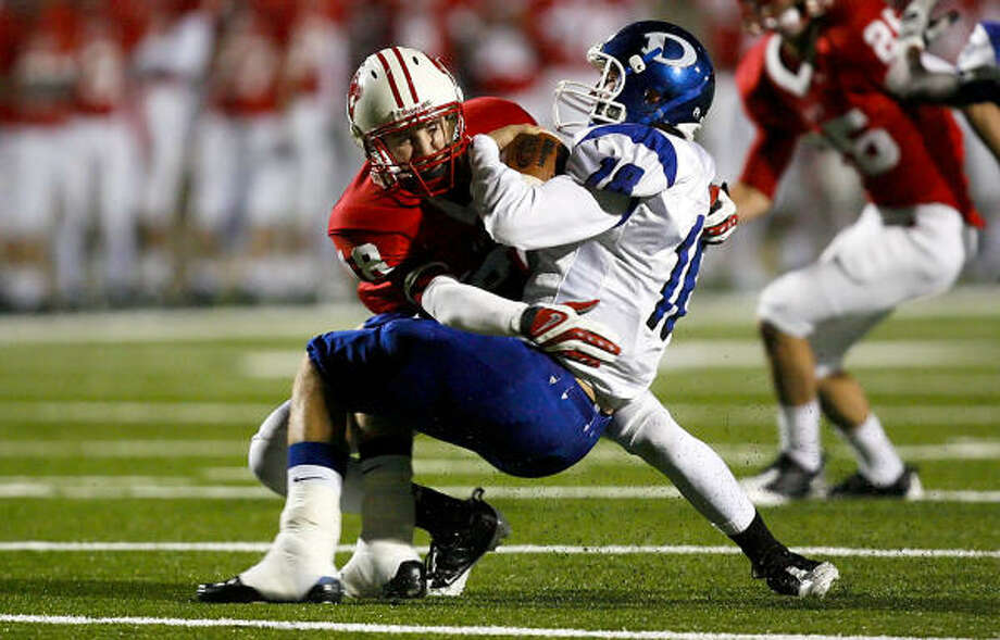 Katy linebacker Caleb Chandler sacks Dickinson quarterback Clay Honeycutt as the Tigers took on the Dickinson Gators at Tully Stadium in the third round of District I  5A playoffs Saturday November 29, 2008. Photo: Diana L. Porter, For The Chronicle