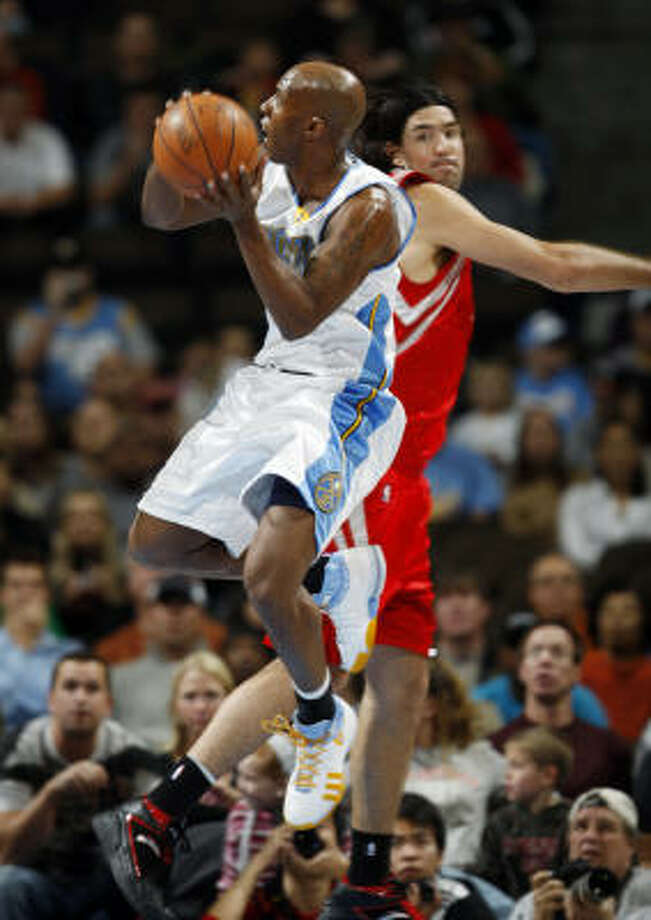 Chauncey Billups, who led Denver with 28 points, soars past Luis Scola. Billups rallied the Nuggets to a win in Denver. Photo: David Zalubowski, AP