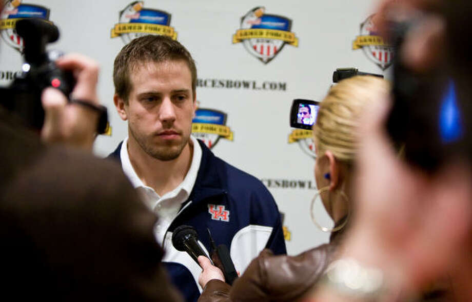 University of Houston quarterback Case Keenum talks to the media after a press conference for the Bell Helicopter Armed Forces Bowl. Photo: Nick De La Torre, Chronicle