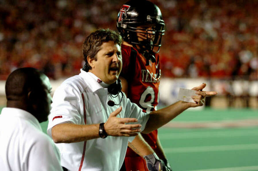 Texas Tech coach Mike Leach argues a call late in the first half against Texas A&M in 2005. The Red