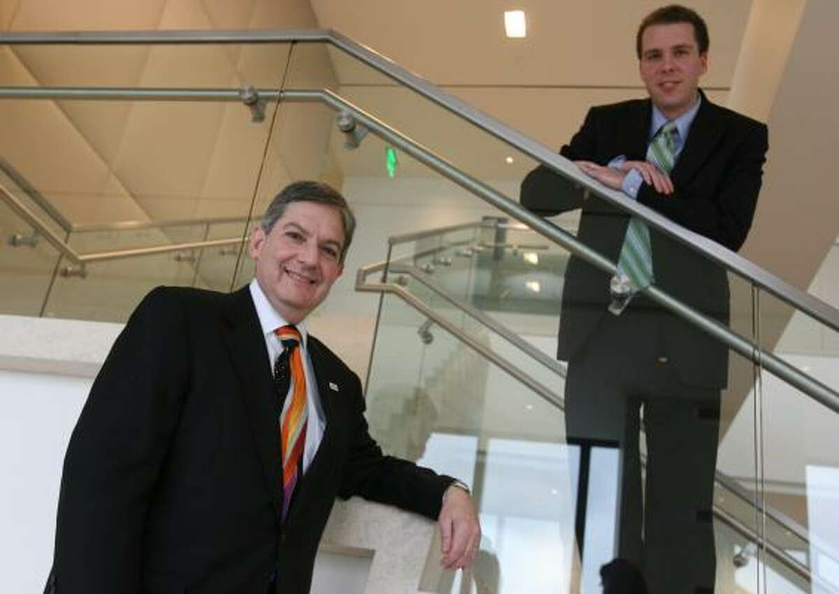 The work of Larry Finder, left, and Assistant U.S. Attorney Ryan McConnell has been cited as critics look at how the Justice Department is dealing with companies accused of wrongdoing.