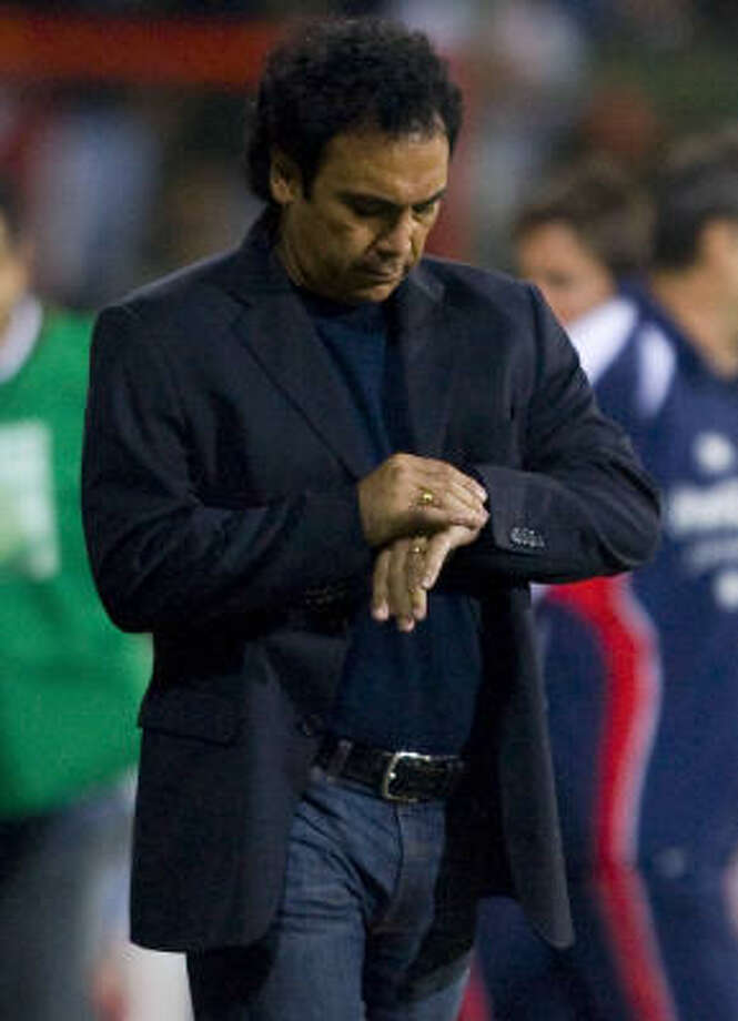 Hugo Sanchez checks the time at the end the first half during their pre-Olympic friendly. Photo: LUIS ACOSTA, AFP/Getty Images
