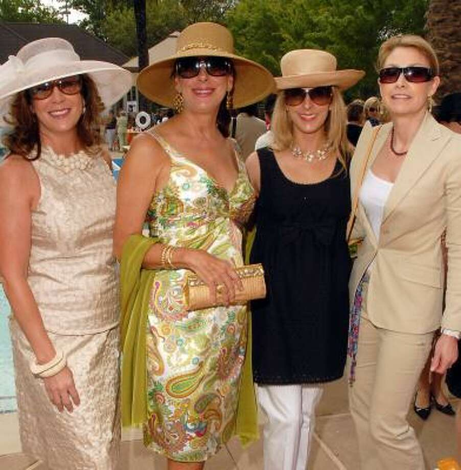 River Oaks Country Club tennis tournament luncheon chair Cherie Flores, from left, gathered with friends Vesta Frommer, Patricia Griffith and Molly Hubbard before the Tootsies fashion show began. Photo: DAVE ROSSMAN, FOR THE CHRONICLE