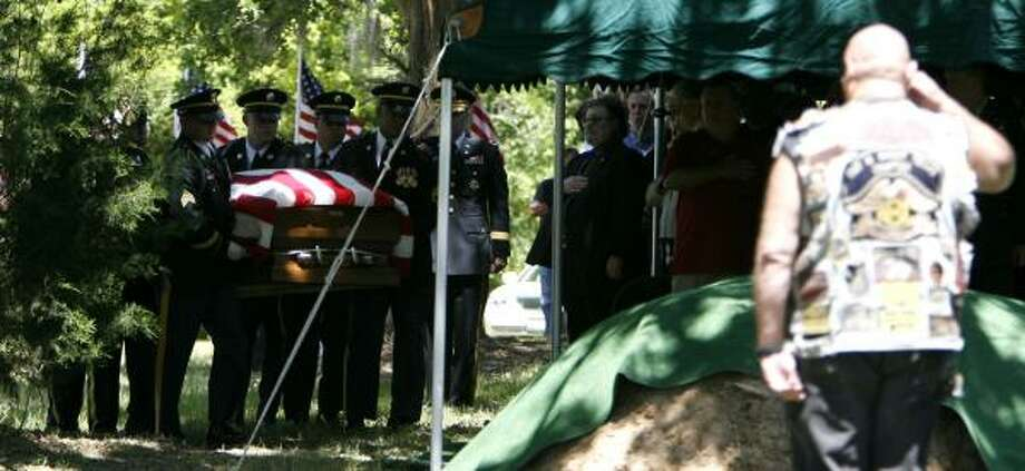 A military honor guard carries the casket of Staff Sgt. Jeffery Lee Hartley to his burial site near Hempstead on Saturday. Hartley died from a roadside bomb in Iraq, where he'd served four tours of duty. At his funeral, a second Bronze Star and a Purple Heart were bestowed. Photo: KAREN WARREN, CHRONICLE