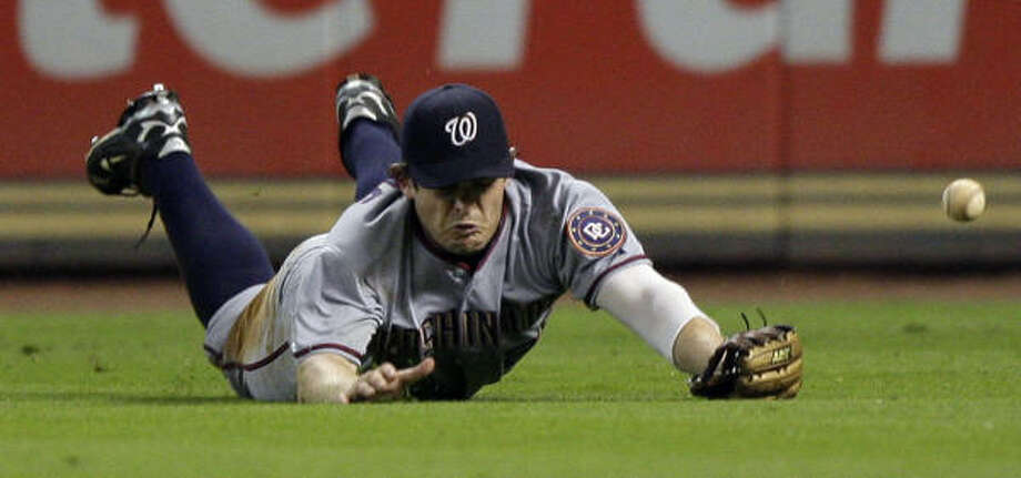 Nationals right fielder Austin Kearns dives for a ball hit by Astros' Carlos Lee during the eighth inning. Photo: David J. Phillip, AP