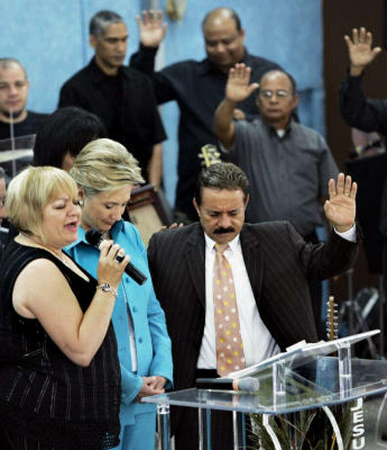Sen. Hillary Rodham Clinton prays at Pabellon de la Victoria Church in Hormigueros, Puerto Rico, on Sunday. Photo: Elise Amendola, Associated Press