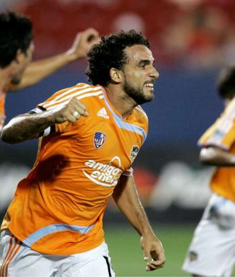 A win over D.C. United will propel the Dynamo (3-3-5) into sole possession of first place in the MLS Western Conference. (Dwayne DeRosario photograhped in May) Photo: Tony Gutierrez, AP
