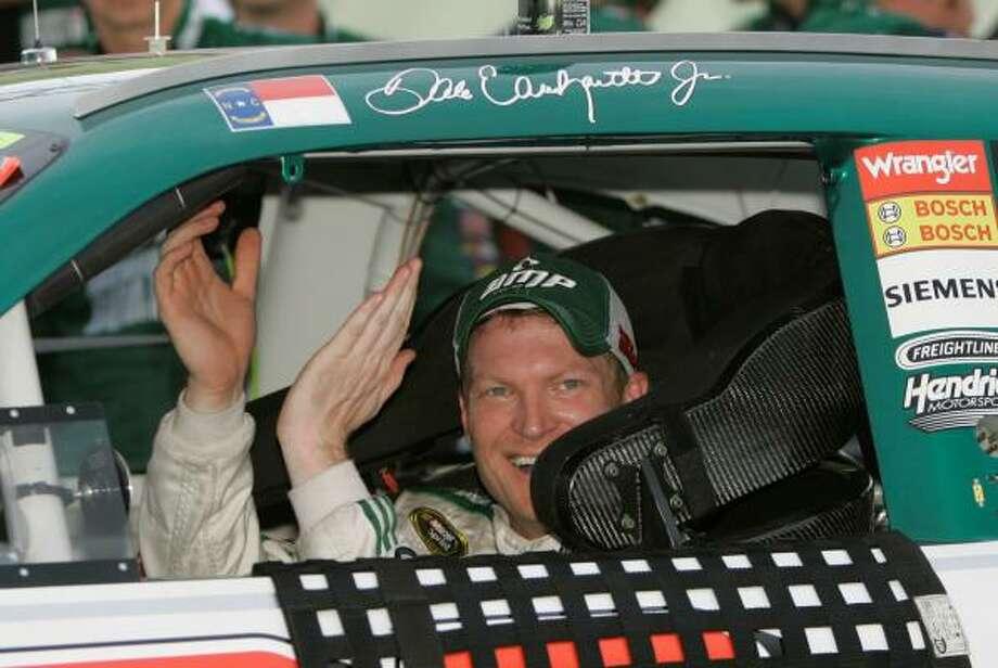 NASCAR Sprint Cup Series driver Dale Earnhardt Jr. celebrates his LifeLock 400 win. Photo: Carlos Osorio, AP