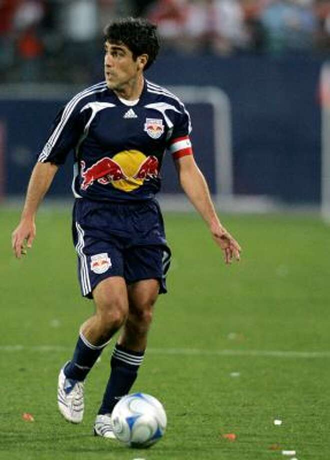 In this April 12, 2008 photo, New York Red Bulls' Claudio Reyna controls the ball during an MLS soccer match against FC Dallas. Photo: Tony Gutierrez, AP
