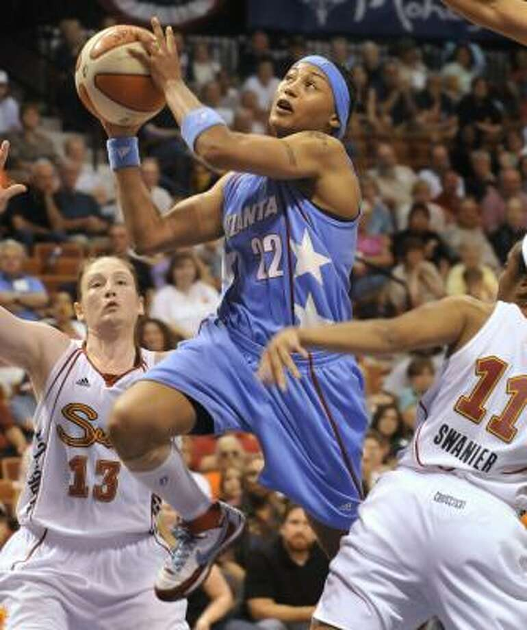 Despite a 44-point effort from Betty Lennox (with ball), the Atlanta Dream remained winless as they fell to Connecticut 109-101 in overtime. Photo: Jessica Hill, AP