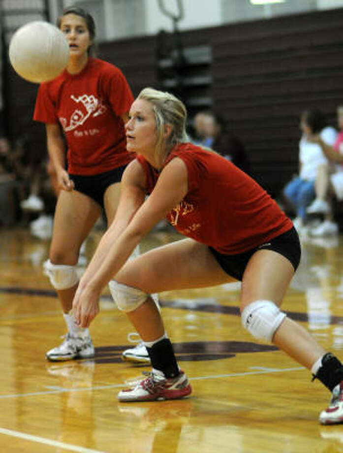 Tomball junior Brooke Hopper, 16, passes to a teammate during the Magnolia Summer Volleyball League Championships on Tuesday. In the background is junior Celeste Allen. Photo: Jerry Baker