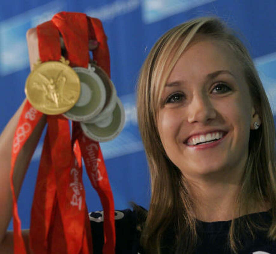 Gymnast Nastia Liukin won five medals at the Olympics in Beijing, including gold in the all-around competition. Photo: Donna McWilliam, Associated Press