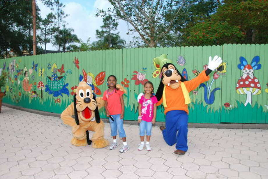 The 8-year-old traveled with her parents, and her younger sister, Charlee Harvey, 6, to Disney World