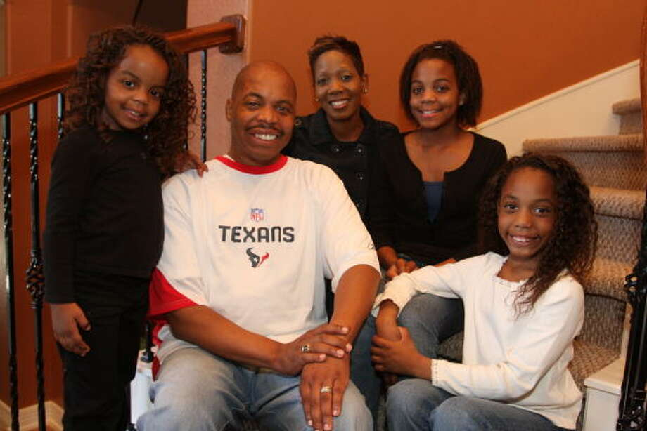 BACK AT HOME: Christopher Hartwell poses with his family, including daughter Charity Iman, 4, left, wife Katrina, and daughters Kristian Victoria, 13, and Destiny Vashti, 7. Photo: Suzanne Rehak