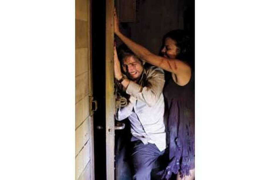 Michael Stahl-David, left, and Jessica Lucas star in Cloverfield. Photo: Paramount
