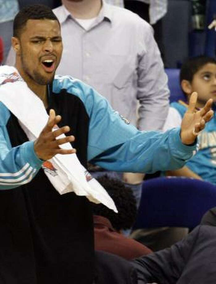 Tyson Chandler is upset by a late call that goes against New Orleans. Photo: ANN HEISENFELT, AP