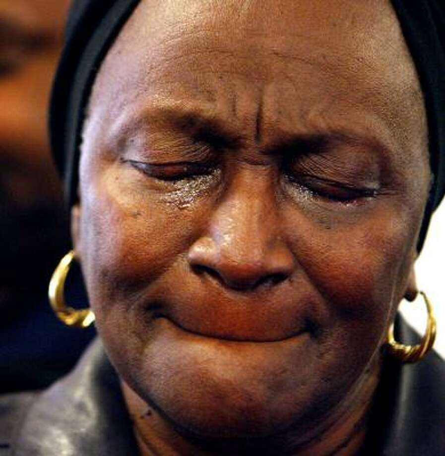 Zella Cathey weeps and prays with members of the Binghampton community Tuesday. Photo: MIKE BROWN, THE COMMERCIAL APPEAL