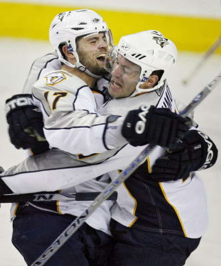 J.P. Dumont (right) had the winner in overtime for Nashville. Photo: Jeff McIntosh, AP