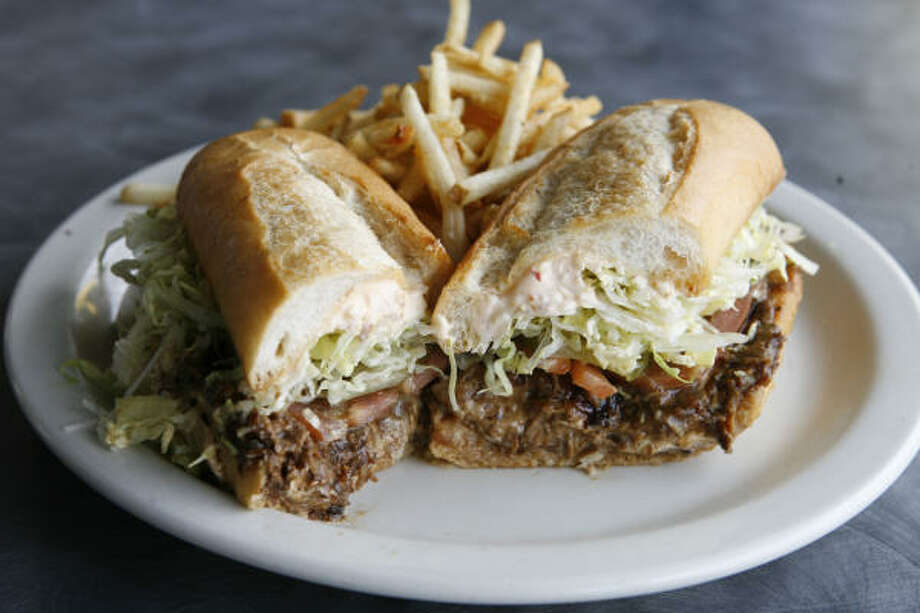 "The ""Midnight Masterpiece"" shredded roast beef po-boy at BB's. Photo: James Nielsen, Houston Chronicle"