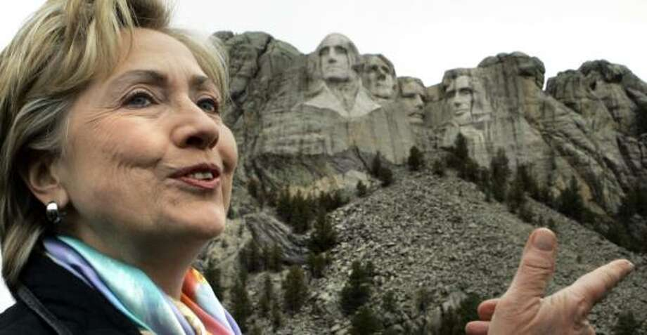 Sen. Hillary Rodham Clinton views the presidential carvings at Rushmore as she campaigns near Keystone, S.D., on Wednesday. South Dakota holds its primary on June 3. Photo: ELISE AMENDOLA, ASSOCIATED PRESS