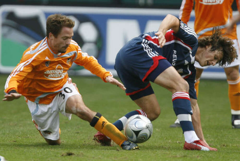 In his first game back since June 12, Richard Mulrooney, left, (shown in the 2007 MLS final against the Revolution's Wells Thompson) played the whole 90 minutes against Chivas on Wednesday. Photo: James Nielsen, Chronicle