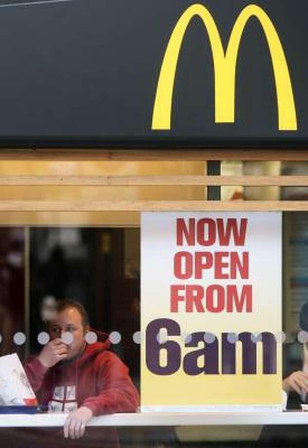 Customers eat at a McDonald's in London. Photo: MATT DUNHAM, ASSOCIATED PRESS FILE