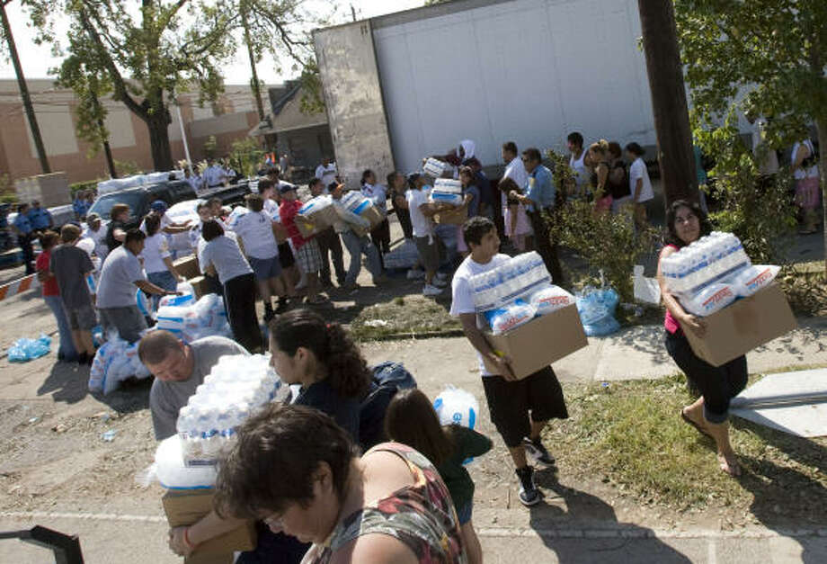 A FEMA  POD distributes ice, water and MRE's at the Zion Lutheran Church on Monday in Houston. Photo: James Nielsen, Chronicle
