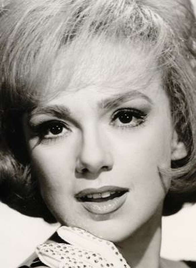 "** FILE ** Edie Adams poses in this 1963 file photo for her variety special ""Here's Edie."" Adams, the blond beauty who won a Tony Award for bringing Daisy Mae to life on Broadway and was television foil for her husband, Ernie Kovacs, died Wednesday Oct. 15, 2008, in a Los Angeles hospital from pneumonia and cancer, publicist Henri Bollinger said. She was 81. (AP Photo/FILE) Photo: AP"