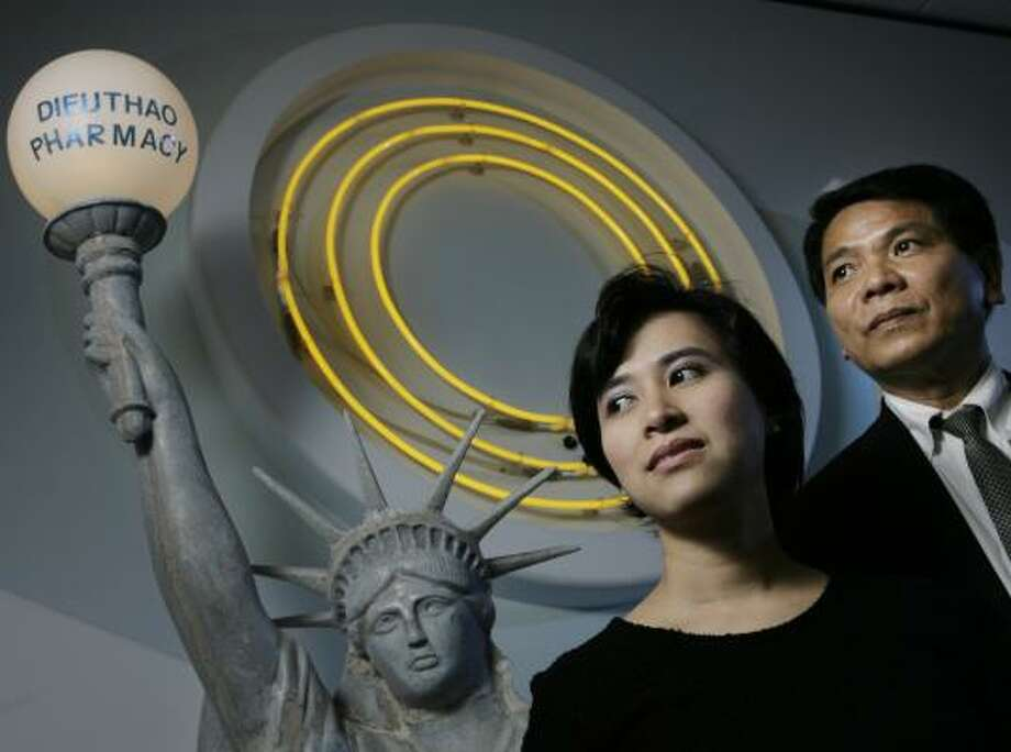 McCain backers Dieuthao Nguyen and her husband, Alvin Dieu Van Nguyen, have a replica of the Statue of Liberty inside their office. Photo: ERIC KAYNE, CHRONICLE
