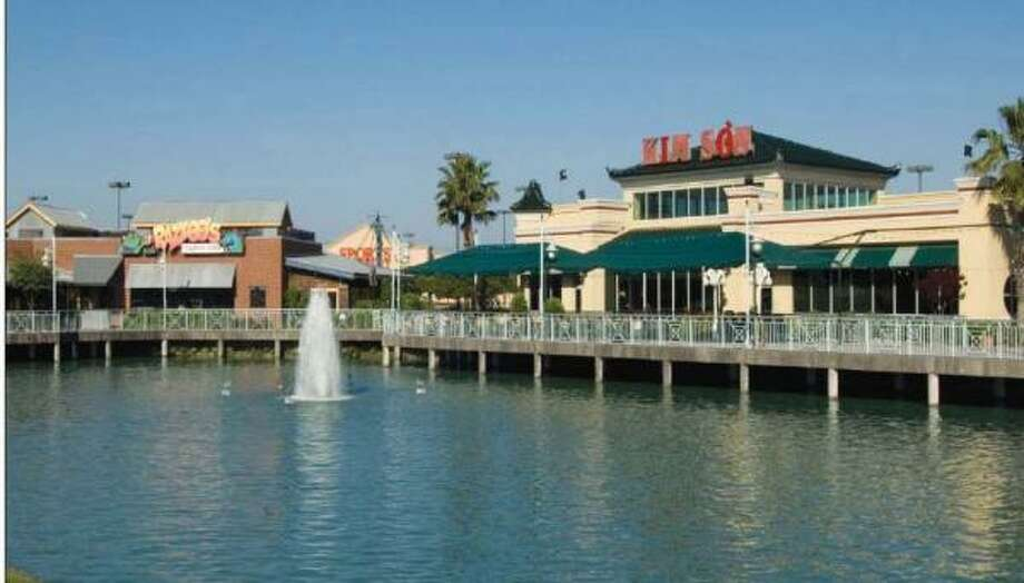 Fountains on the Lake in Stafford, 20 miles from downtown Houston, likely will get an additional 50,000 square feet of retail space, following its purchase by Pacific Coast Capital Partners and Dunhill Partners. Photo: CB RICHARD ELLIS