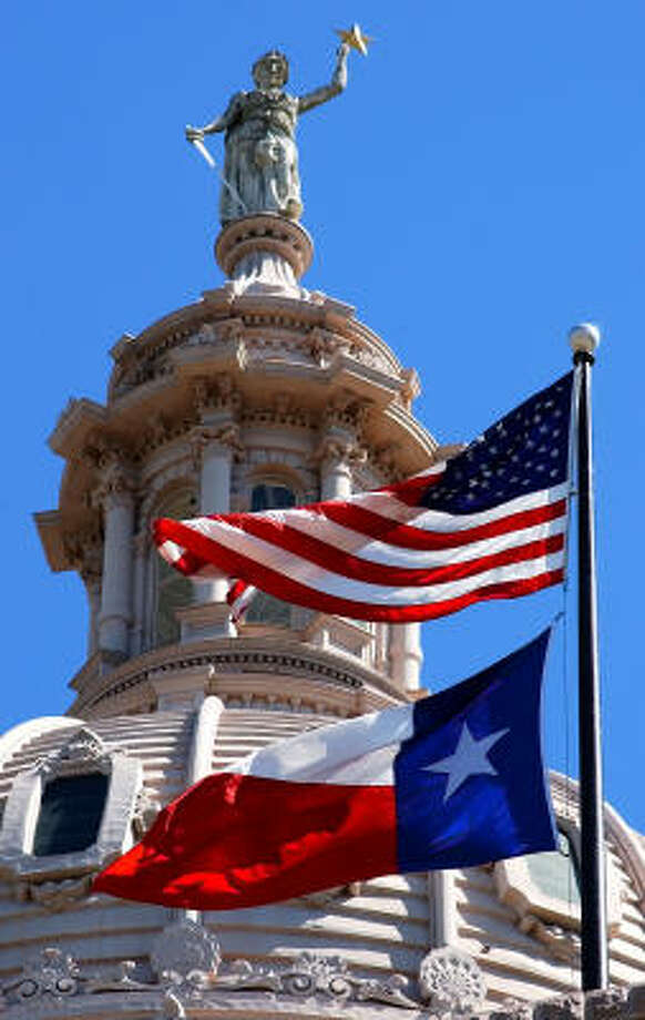 Columbia, Goddess of Liberty, is shown atop the Capitol Dome on Wednesday, April 14, 2004, in Austin. Photo: HARRY CABLUCK, AP File