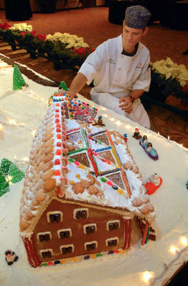 Executive pastry chef Kevin Pysell puts the finishing touches on the display at The Woodlands Resort and Conference Center's 10th Annual Storybook Christmas display. Photo: David Hopper, For The Chronicle