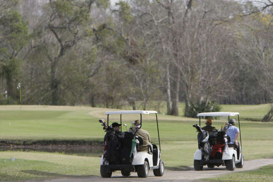 Most golfers will find a way to get to courses like the Masters Course at Bear Creek, even in tough times. Photo: Melissa Phillip, Houston Chronicle