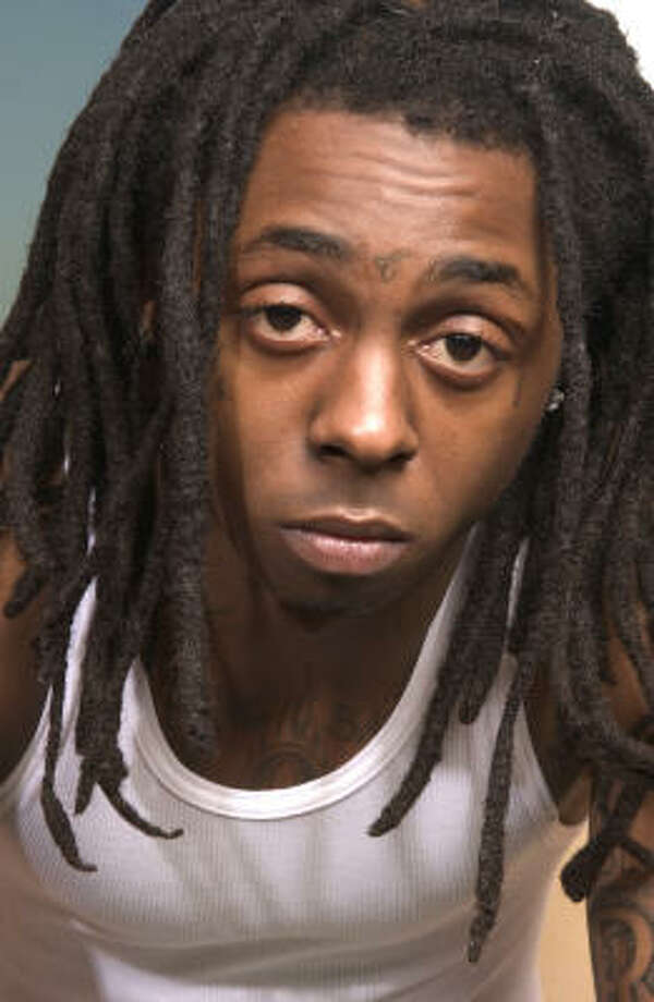 Now free on bail, Lil Wayne, whose real name is Dwayne Michael Carter Jr., was arrested after his tour bus was stopped at a U.S. Border Patrol checkpoint near Dateland, Ariz. Photo: JIM COOPER, Associated Press