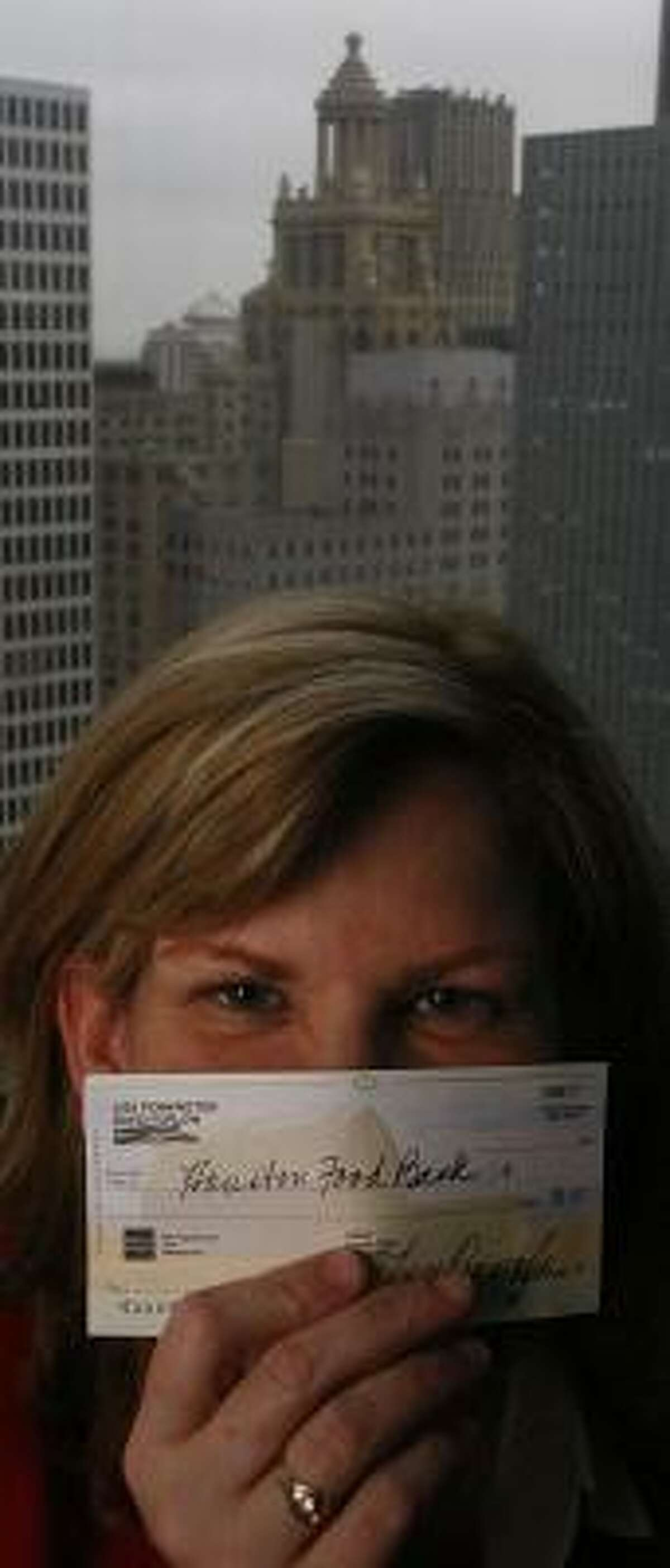 Attorney Lisa Pennington writes a check to the Houston Food Bank at the conclusion of every difficult case she tries.