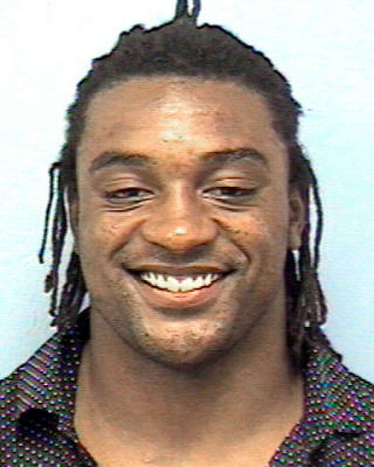 This photo released by the Austin, Texas, Police Department shows former Texas star and former Chicago Bears running back Cedric Benson, who was arrested early, June 7, 2008, in downtown Austin after police said he failed a field sobriety test. Benson was ordered Monday to install an ignition lock breathalyzer in his car while facing charges of driving while intoxicated. Photo: AP