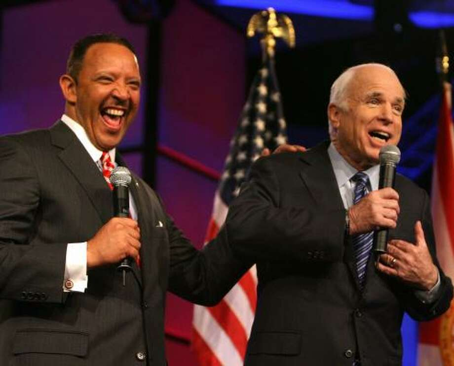 Sen. John McCain jokes with Marc Morial, president of the National Urban League, at the group's annual conference on Friday. Photo: JOE BURBANK, ORLANDO SENTINEL