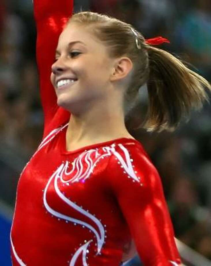 Shawn Johnson smiles after competing during the 2008 Olympic Games in Beijing, China. Photo: AL BELLO, GETTY IMAGES