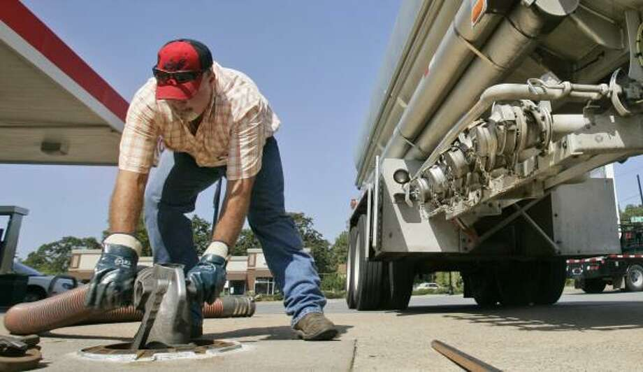 Tanker truck driver Rick Mears delivers fuel to a North Little Rock, Ark., station. A steep drop in energy prices pulled down wholesale inflation in August. Photo: DANNY JOHNSTON, ASSOCIATED PRESS
